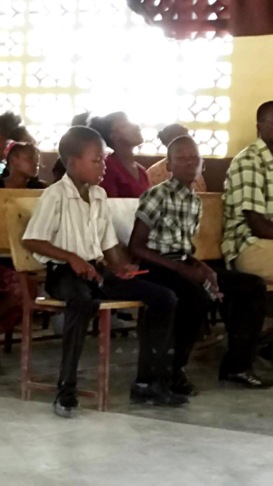 Intently playing drums in church